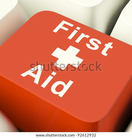 First Aid Computer Red Key Showing Emergency Medical Help - stock photo