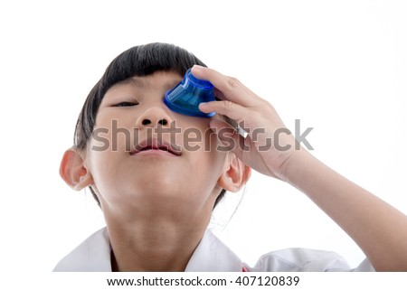First Aid flush eyes with medicine washing white background