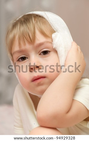 First aid for sudden pain in the ears - stock photo