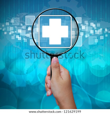 First Aid icon in Magnifying glass on blue background - stock photo