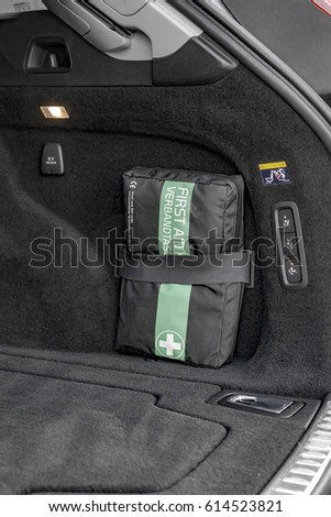 First aid kit in a luxury car trunk