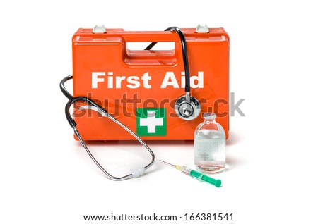 First aid kit with stethoscope and syringe - stock photo