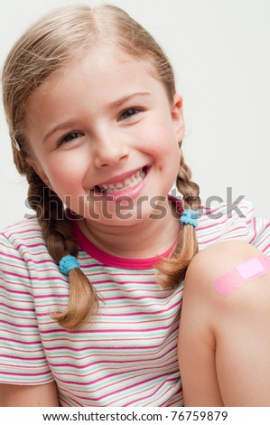First aid - little girl portrait - stock photo