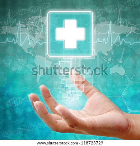 First Aid Symbol on hand, medical icon  - stock photo