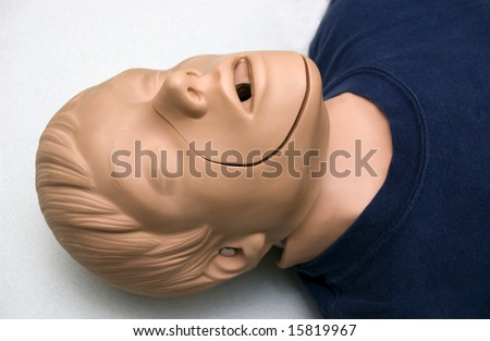 first aid training dummy during a class - stock photo