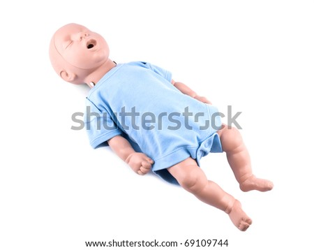 First aid traning infant dummy on white background - stock photo