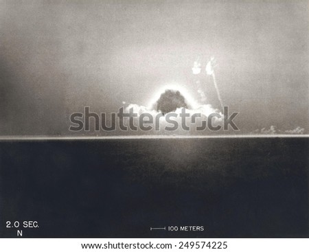 First Atomic Explosion on July 16, 1945. Photograph taken at 2 seconds after the initial Trinity detonation shows the beginning of the Mushroom cloud. Manhattan Project, World War 2. - stock photo