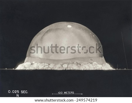 First Atomic Explosion on July 16, 1945. Photograph taken at .025 seconds after the Trinity initial detonation shows a plasma dome. Manhattan Project, World War 2. Alamogordo, New Mexico. - stock photo
