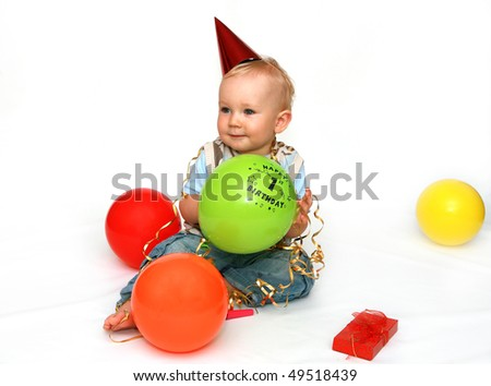 First birthday - happy baby boy with balloons on white background. - stock photo