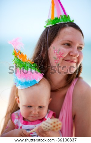 First birthday party. Mother and her baby daughter on birthday party