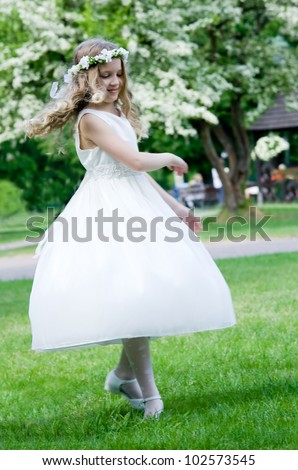 First Communion - happy dance on green background - stock photo