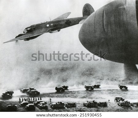 First days of the German Invasion of the Soviet Union in June 1941. German bombers fly over Nazi invasion vehicles. Ca. June 21-24, 1941, during World War 2. - stock photo