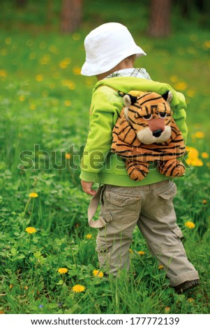 First discovery of a young child. The boy goes into the forest alone. - stock photo