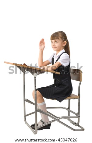 First-form girl sit on the school-bench and raise one's hand