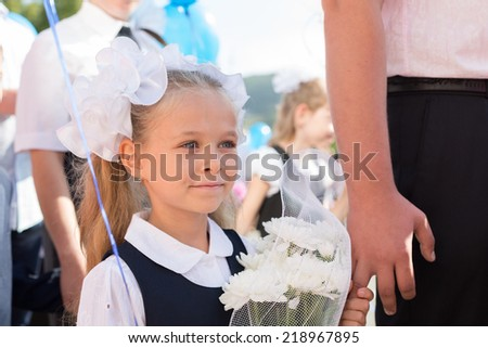 First grader girl in the first day of training at the school. Russia. - stock photo