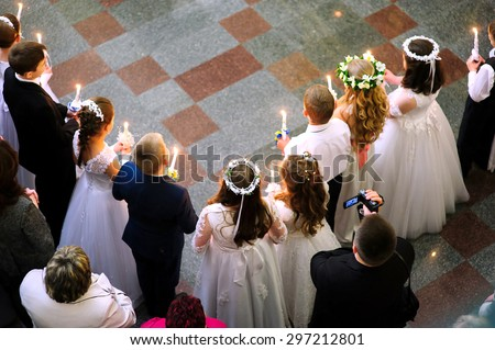 First holy communion in church, many little children - stock photo