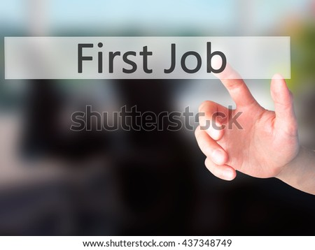 First Job - Hand pressing a button on blurred background concept . Business, technology, internet concept. Stock Photo