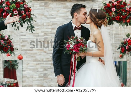 First kiss of just married after the ceremony