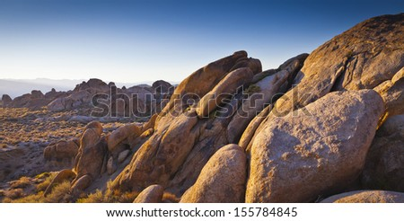 First light at the Sierra Nevada mountains, Alabama Hills in California. - stock photo