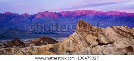 First Light Of Dawn Over Zabriskie Point, Death Valley National Park, California, USA - stock photo