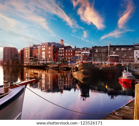 First light on the tugboats and waterfront, Piscataqua River, Portsmouth, New Hampshire - stock photo