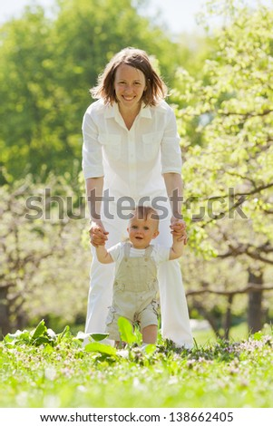 First little boy steps - stock photo