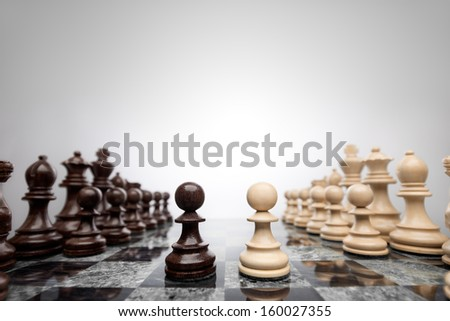 First move: two pawns opposition in the middle of the board . - stock photo