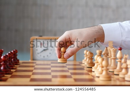 First move with white pawn - stock photo