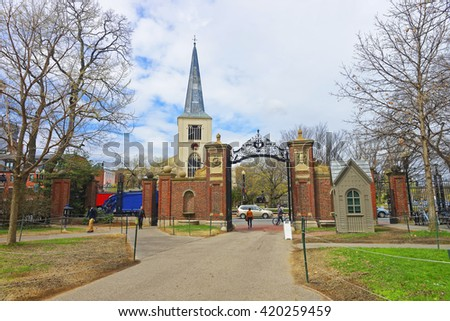 First Parish Church in Cambridge in Harvard Square and tourists at Harvard Yard in the campus of Harvard University in Cambridge, Massachusetts, MA, USA. The church is built 400 years ago. - stock photo