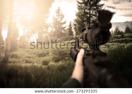 First person view of soldier on duty, photo realistic fps military game - stock photo