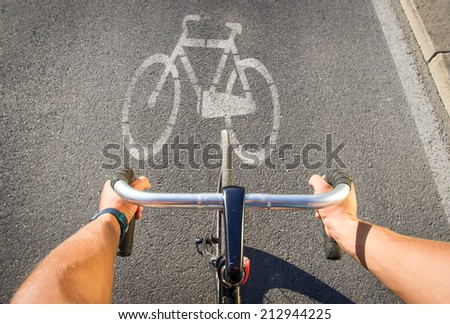 first person view on a bicycle on the path - stock photo