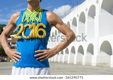 First place athlete wearing 2016 gold medals standing at Lapa Arches Rio de Janeiro Brazil  - stock photo