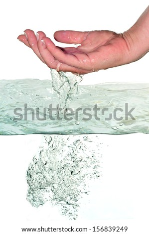 first plane of woman's hand leaving the water     - stock photo