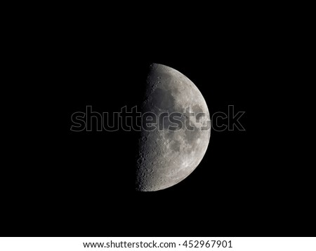 First quarter moon seen with an astronomical telescope (seen through my own telescope, no NASA images used) - stock photo