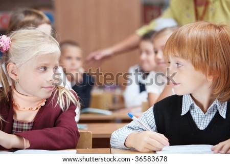First School love in Elementary school. Focus on Girl. - stock photo