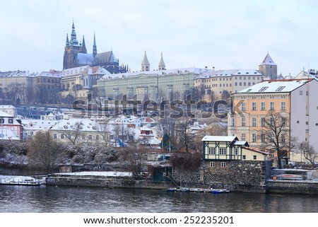 First Snow in Prague, gothic Castle above the River Vltava, Czech Republic - stock photo