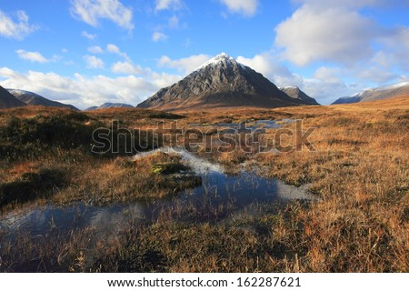 First snow of winter on Buachaille Etive Mor in Glencoe in the Scottish Highlands. - stock photo