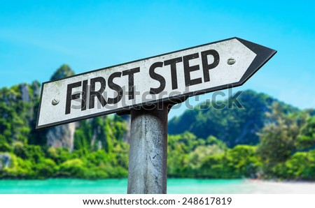 First Step sign with a beach on background
