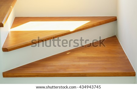 first step wood stairs with sunlight, part of home interior wooden stairs