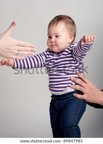 First steps of a baby girl - stock photo