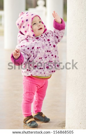 first steps of baby girl outdoors