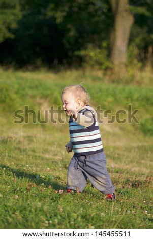 First Steps of Child - stock photo