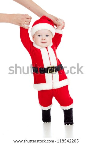 first steps of funny Santa claus baby - stock photo