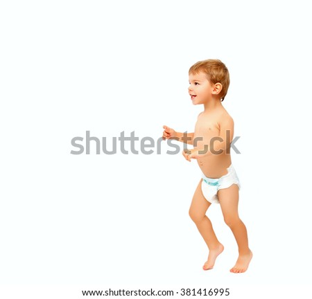 First steps of happy baby boy isolated on white - stock photo