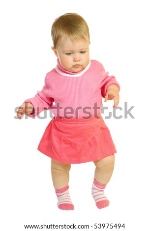 First steps of small baby in red dress - stock photo