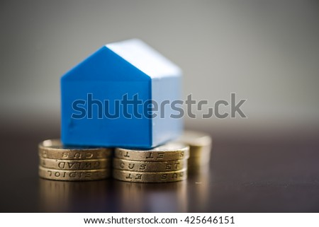 First time home buyers savings, getting on property ladder - stock photo