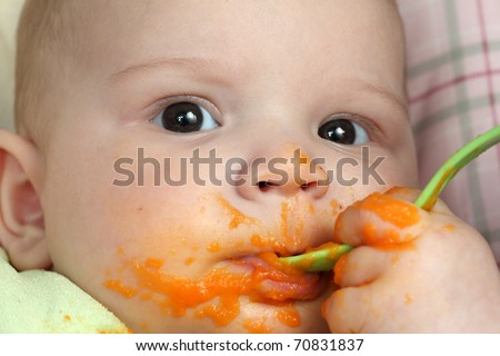 First time with a spoon - stock photo