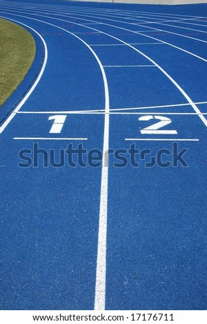 First two lanes of blue running track - stock photo
