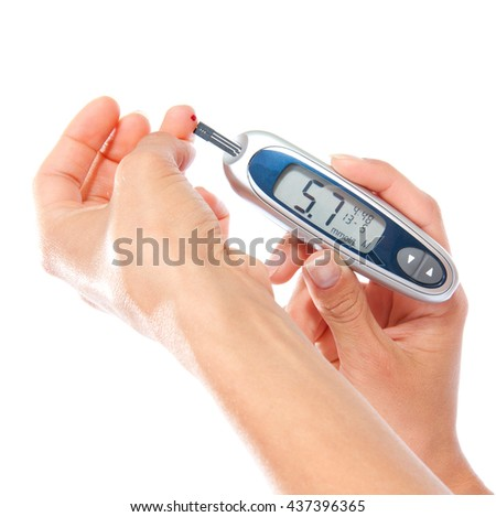 First type Diabetes patient measuring glucose level blood test use glucometer and small drop of blood from finger and test strips isolated on a white background - stock photo