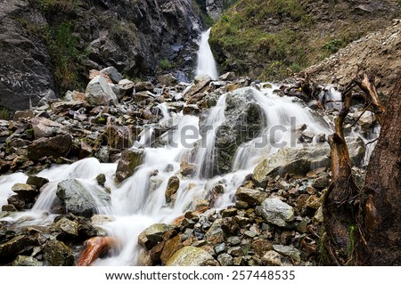 First waterfall in gorge Ayu-Say and flow of water on stone - stock photo